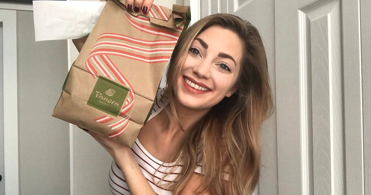 woman smiling holding panera bag
