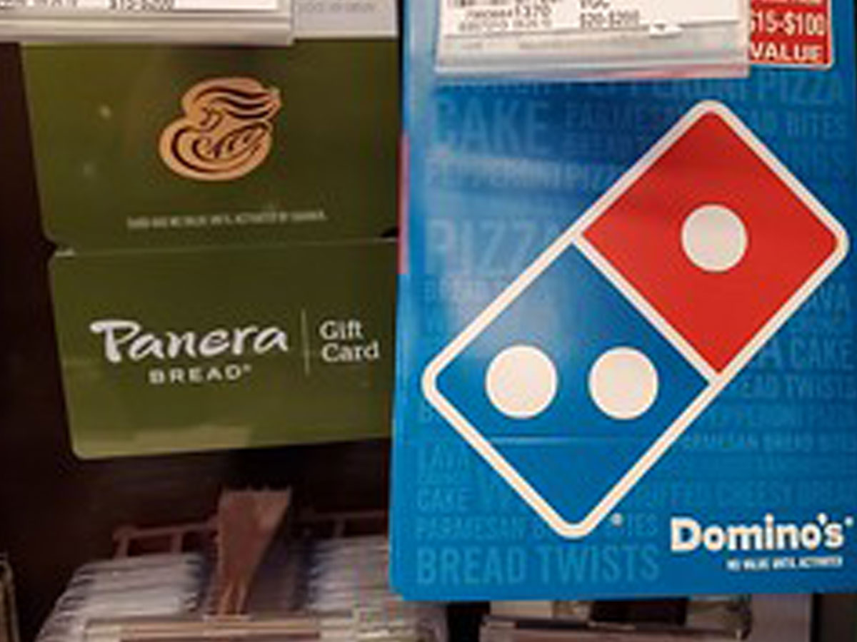 panera bread gift card and domino's gift card hanging on display