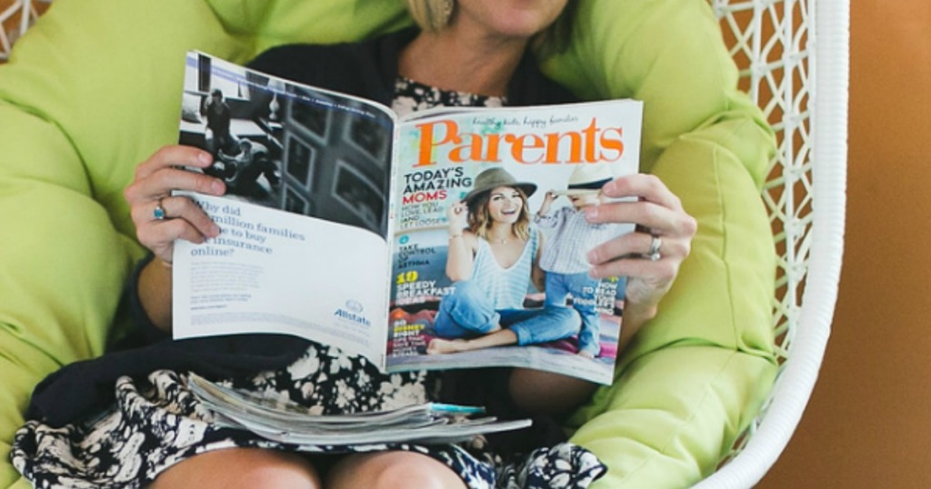 woman reading magazine while lounging on chair