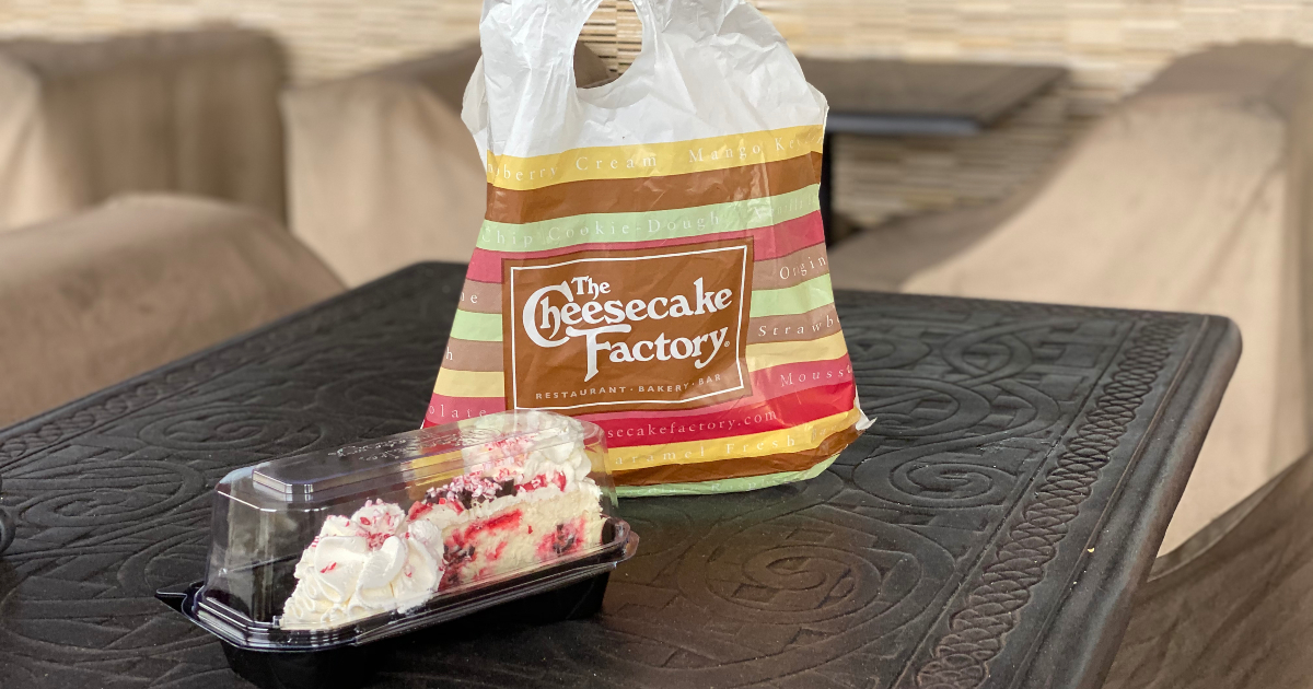 piece of cheesecake next to The Cheesecake Factory bag