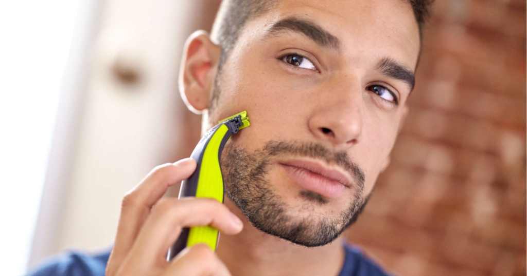 man shaving with philips norelco razor