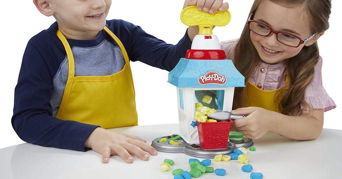 girl and boy playing with the Play-Doh Kitchen Creations Popcorn Party Play Food Set