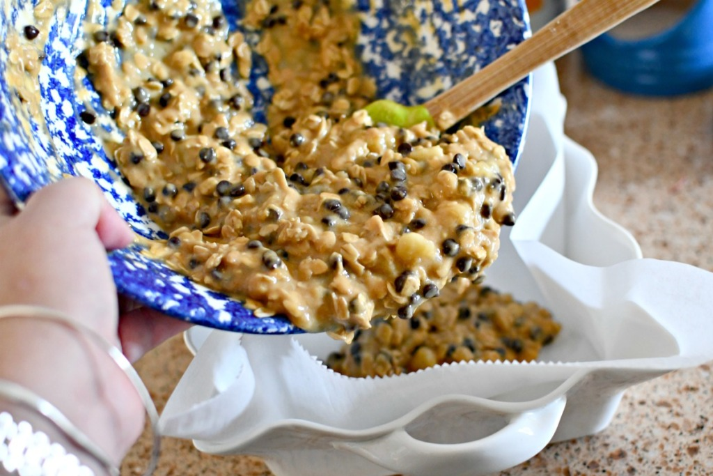 pouring oatmeal batter into baking pan