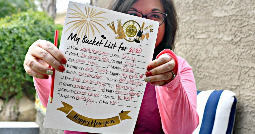 Lina holding printable bucket list for New Year's