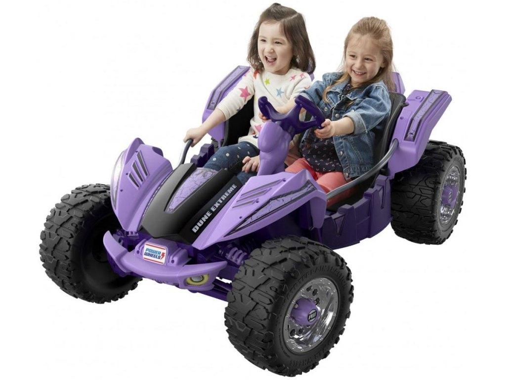 two girls riding Power wheels extreme ride on toy
