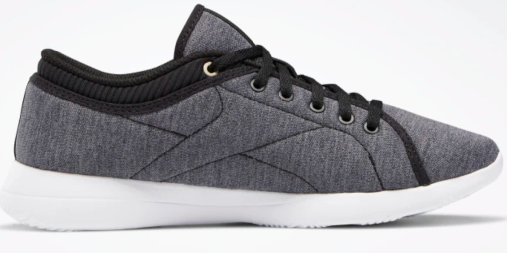 gray shoes with black laces and white soles