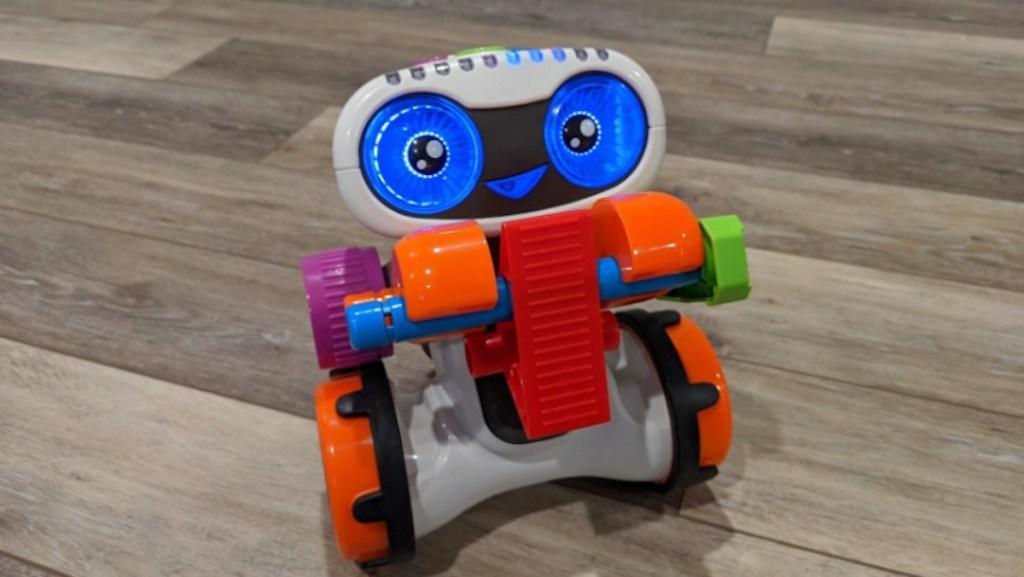 popular kids toys christmas 2020 colorful robot on wood floor