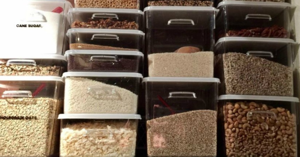 containers holding food storage on shelf