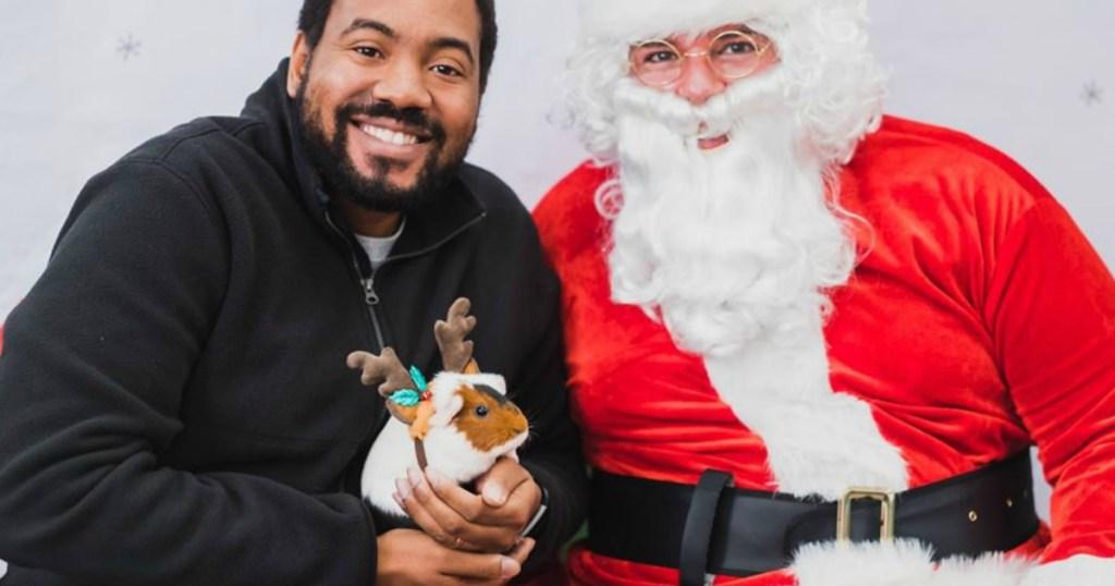 santa claus and man holding pet hamster