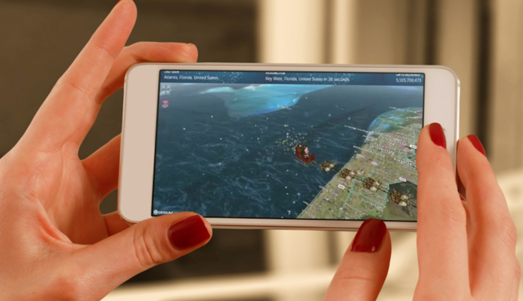 hands holding a phone with santa tracker on screen