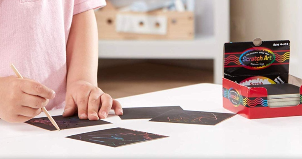kid using scratch art