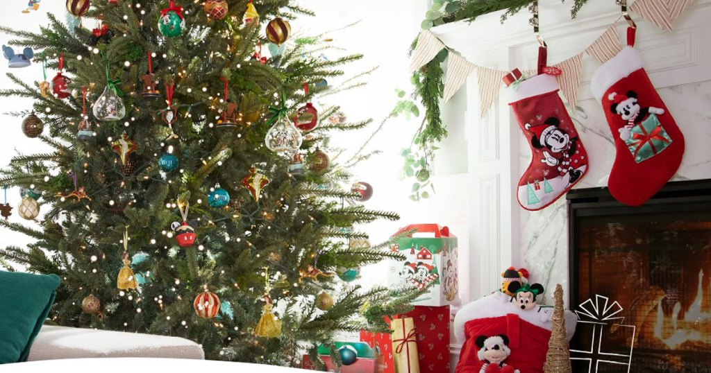 shopdisney christmas scene of living room tree and stockings by fireplace