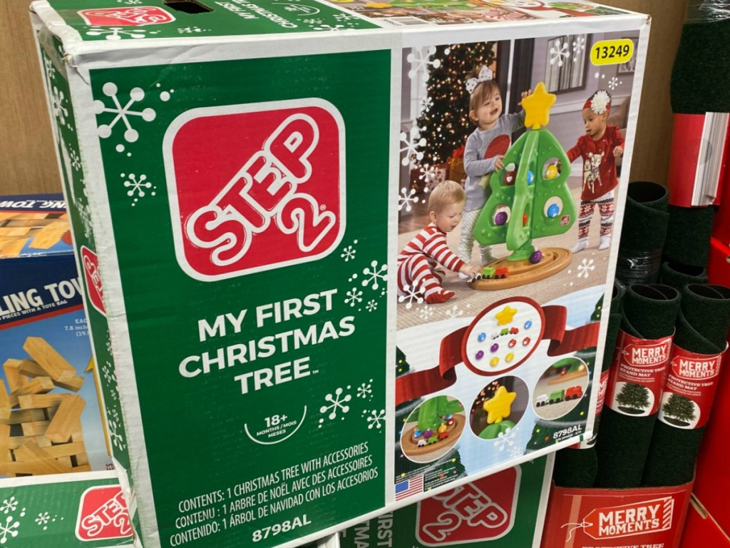box with giant plastic kids toy shaped like a Christmas tree