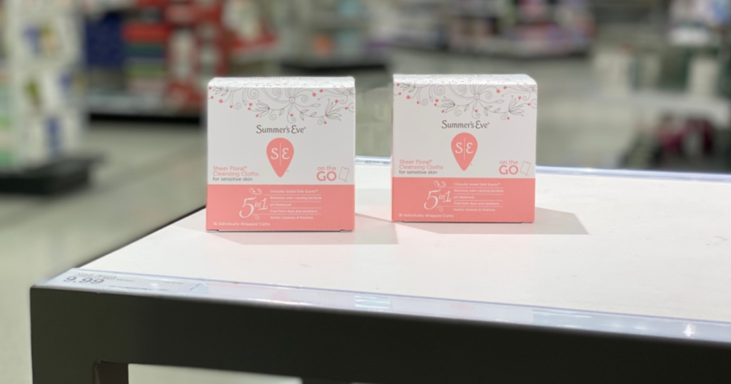 two white and peach boxes on counter
