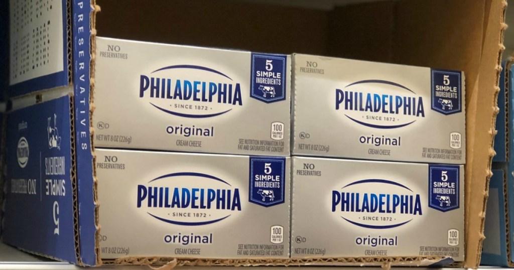 philadelphia cream cheese blocks on a shelf in a store
