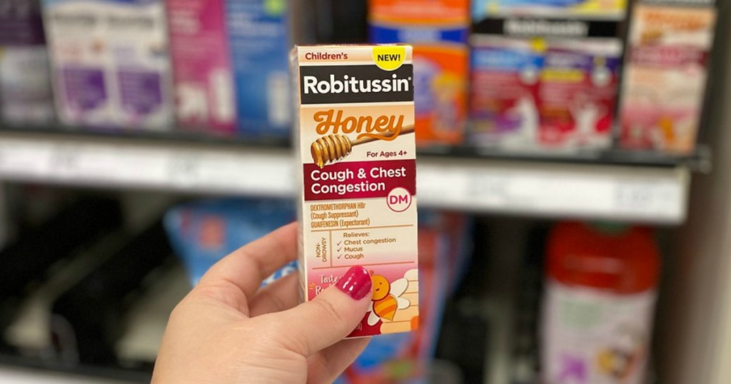 hand holding cold medicine in a store