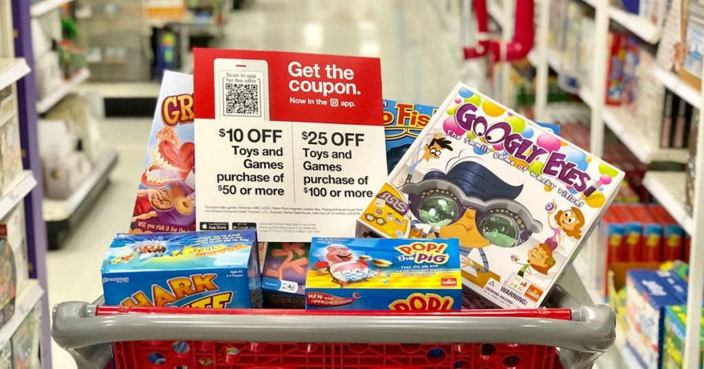 Target shopping cart full of games and toy sign