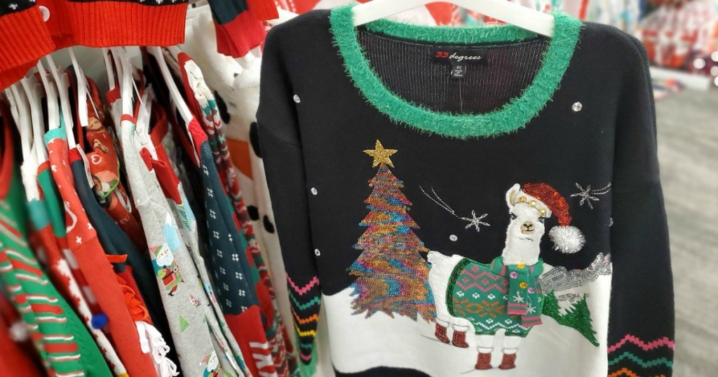 hand holding ugly holiday sweater in a store