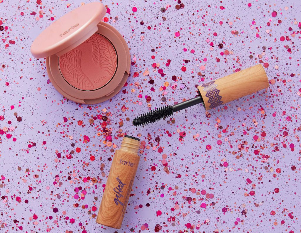 tarte beach, sleep, repeat color collection with blush and mascara on purple and pink spotted background