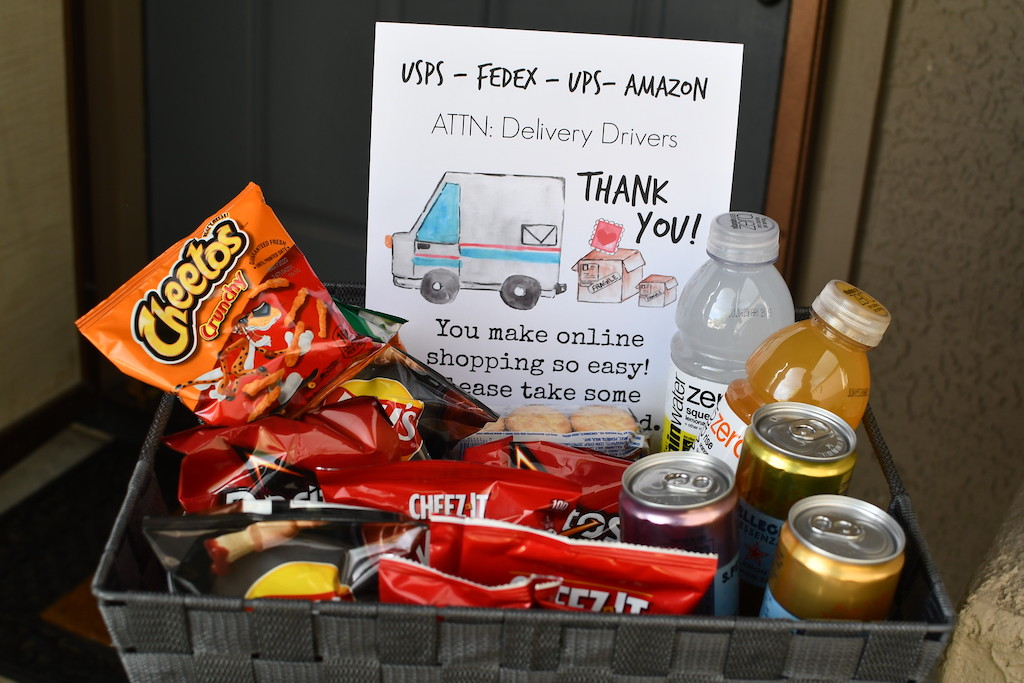 Thank you delivery driver sign in basket with snacks by front door