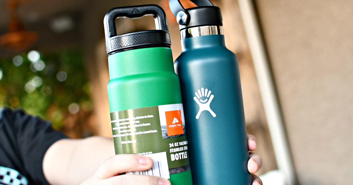 person holding an Ozark Trail and Hydro Flask water bottles