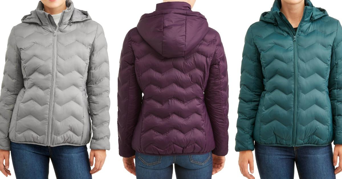 women wearing puffer coats stock images