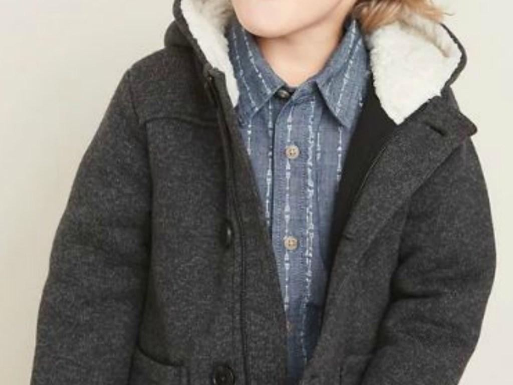 child wearing gray jacket