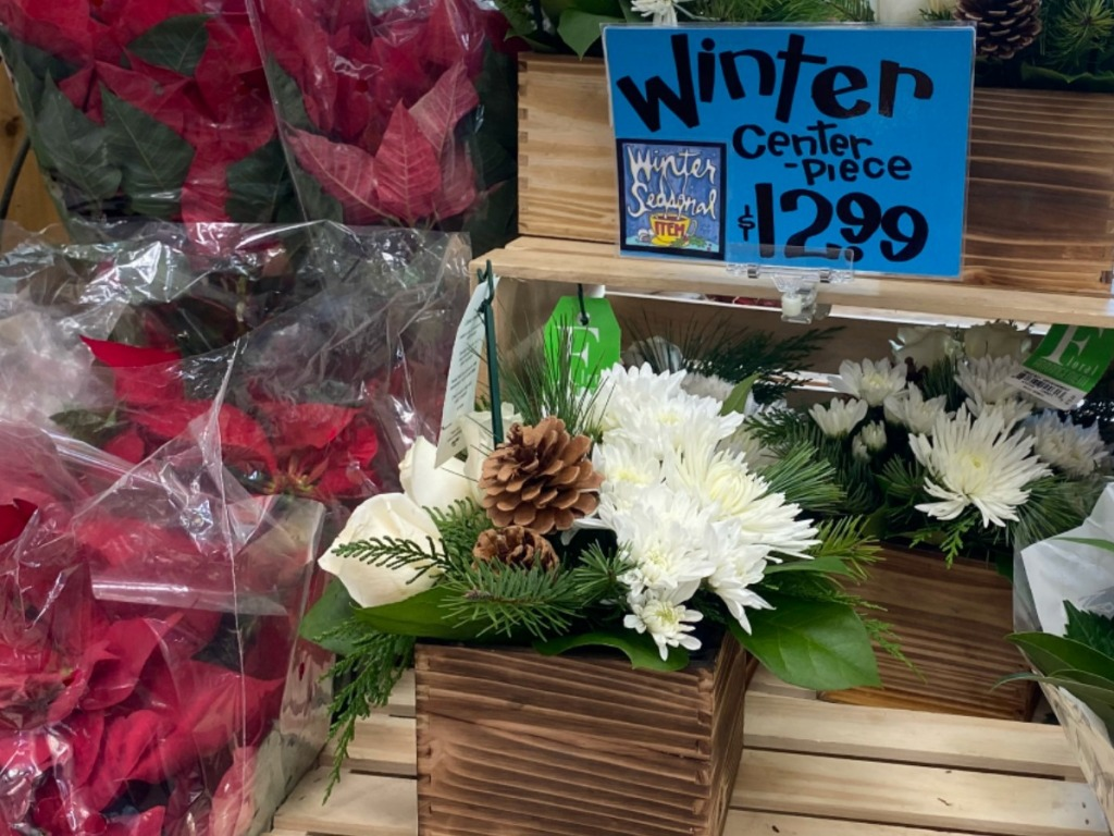 flower arrangment sitting on wooden box of store display