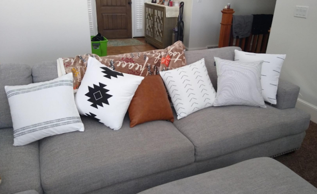 various throw pillows on gray couch in living room
