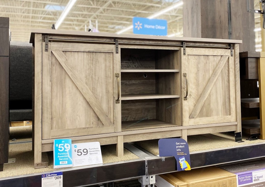 gray farmhouse tv console stand sitting on store shelf