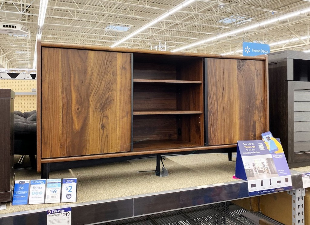 wooden tv stand sitting on store shelf