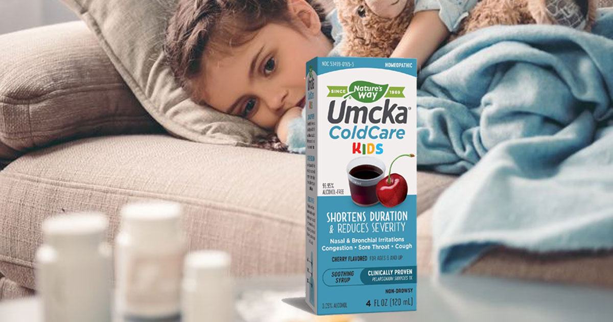 sick little girl laying on couch with teddy bear staring at Nature's Way Umcka ColdCare Kids Syrup