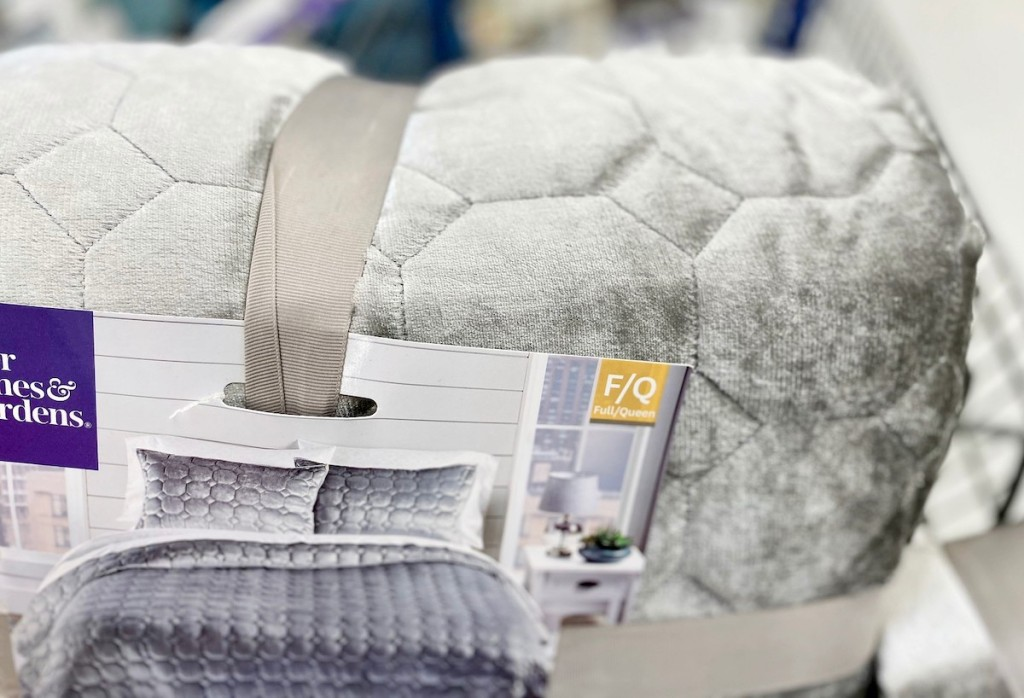 gray velvet quilt in packaging