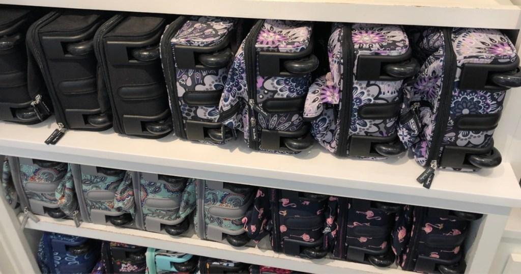 vera bradley luggage on shelf at store