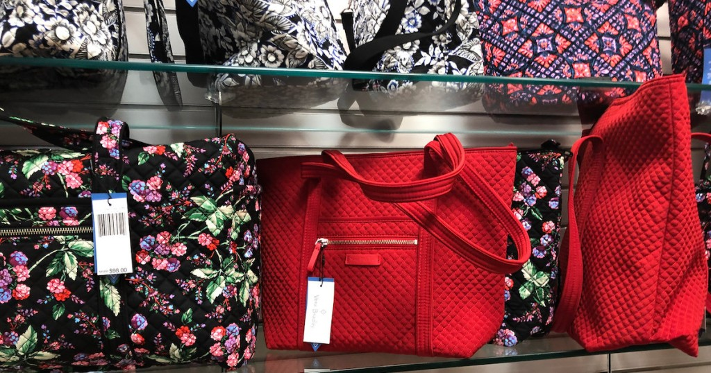 bright red and floral vera bradley bags on store shelf
