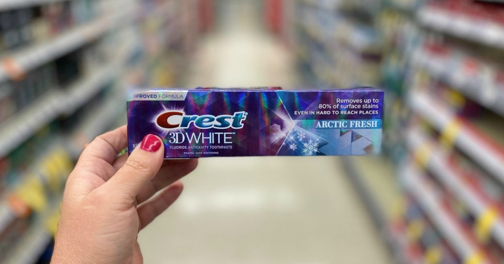 hand holding toothpaste in a store