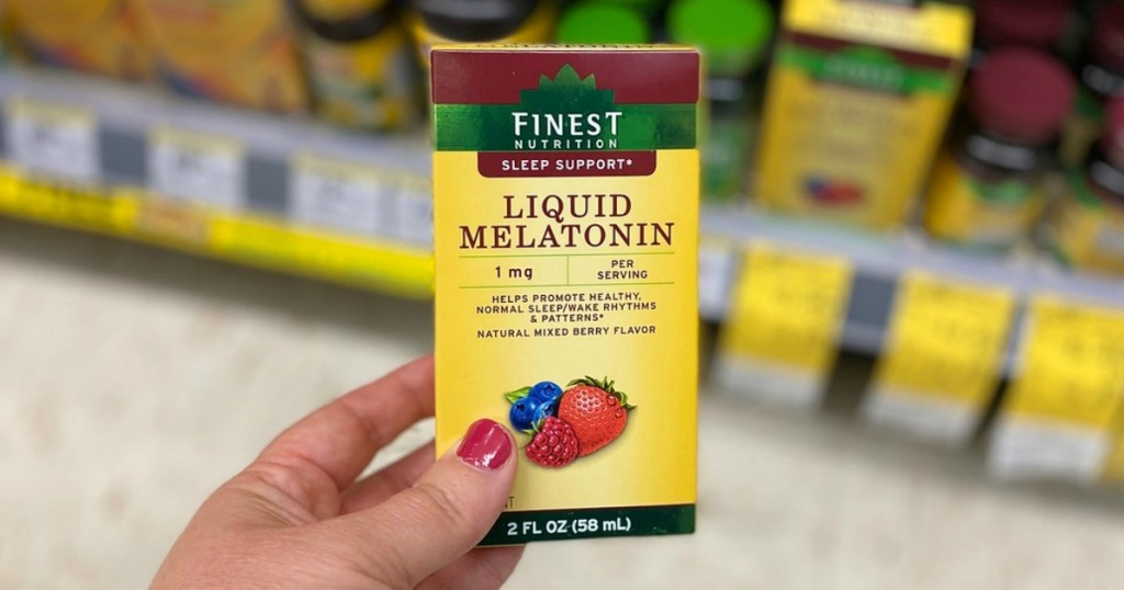 hand holding vitamins in a store