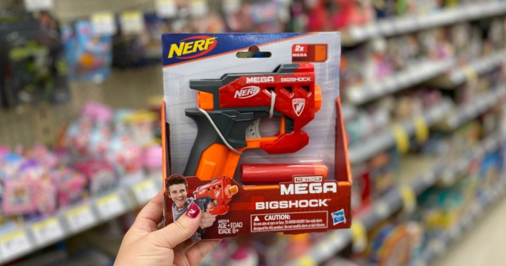 hand holding toy gun in a store