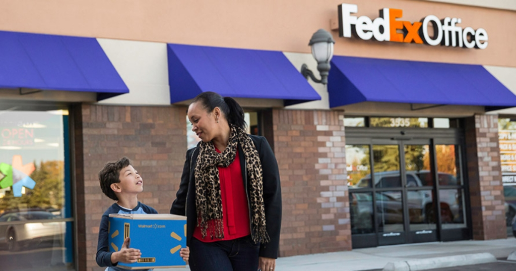 Woman and child with Walmart package outside FedEx Office