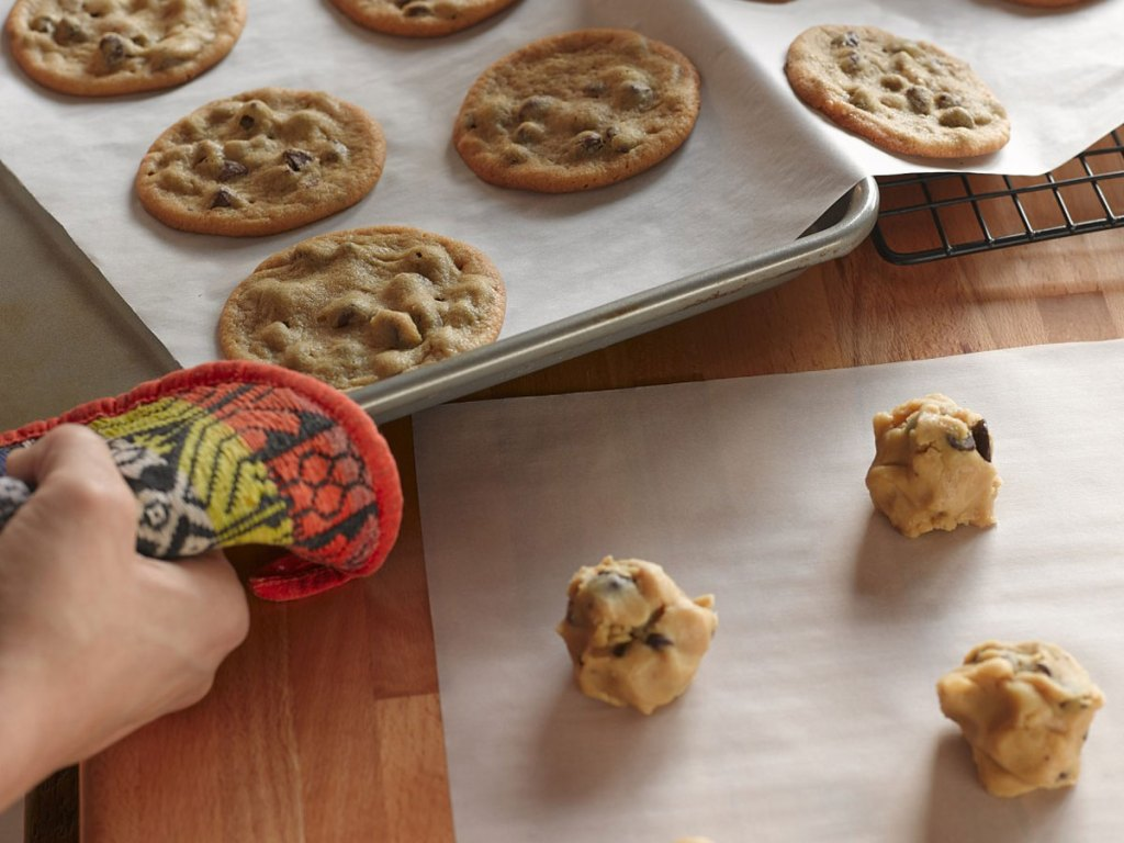 baking sheets on wax paper with cookies