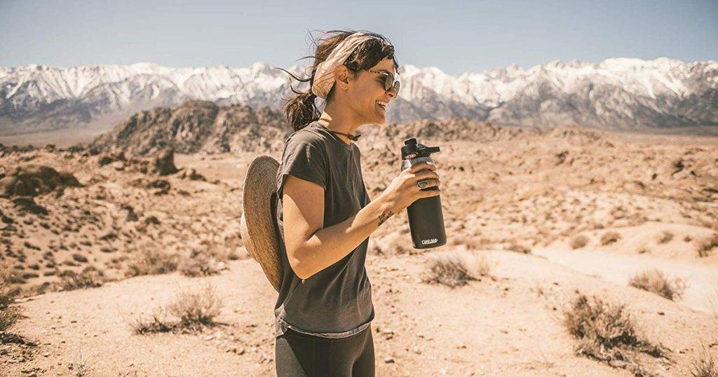 woman-standing-in-desert-with-camelbak