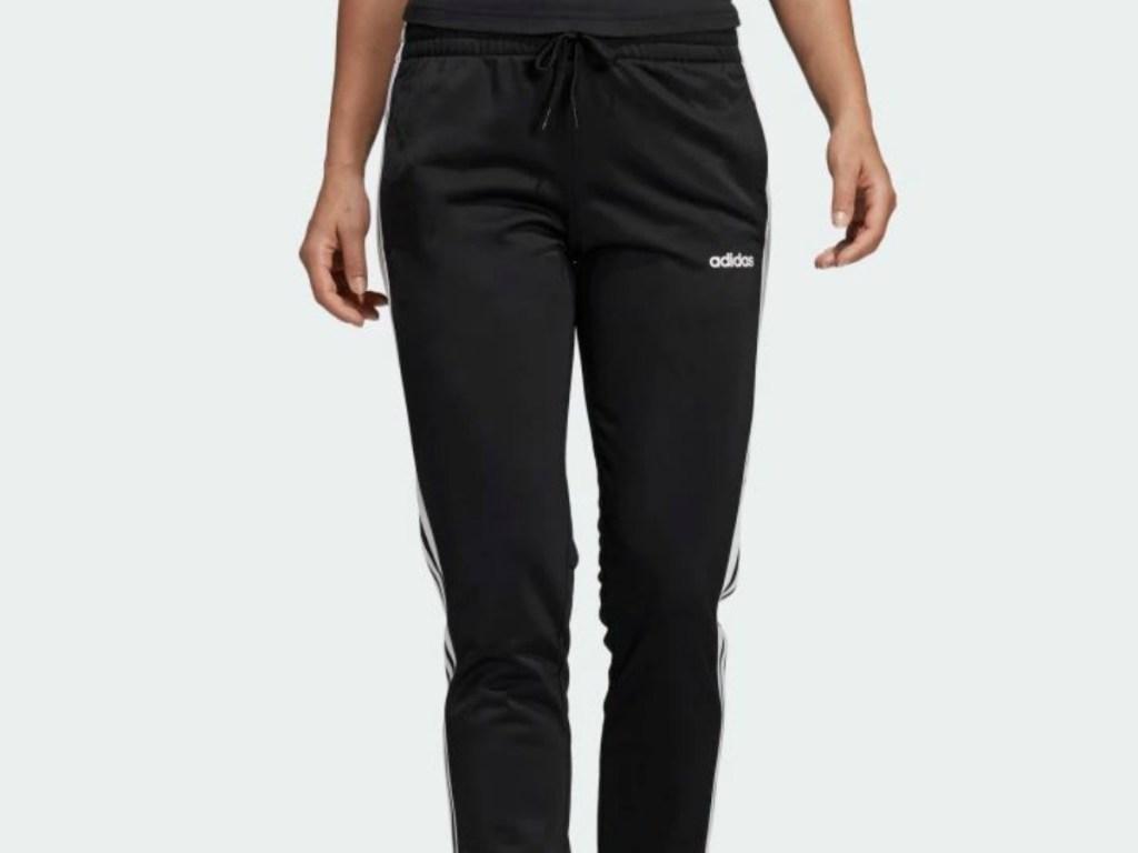 woman walking in black track pants