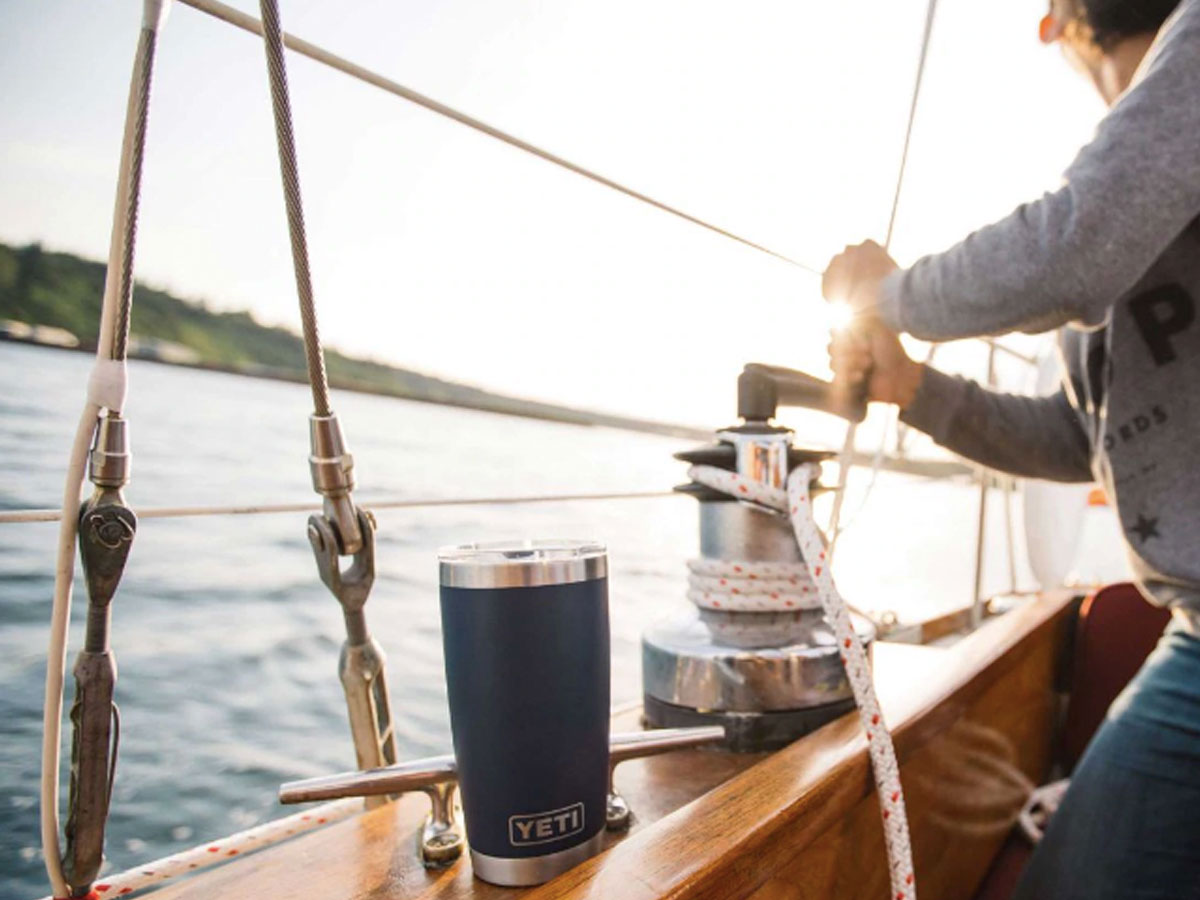 picture of a yacht on water with a YETI 20oz Rambler Tumbler with MagSlider Lid