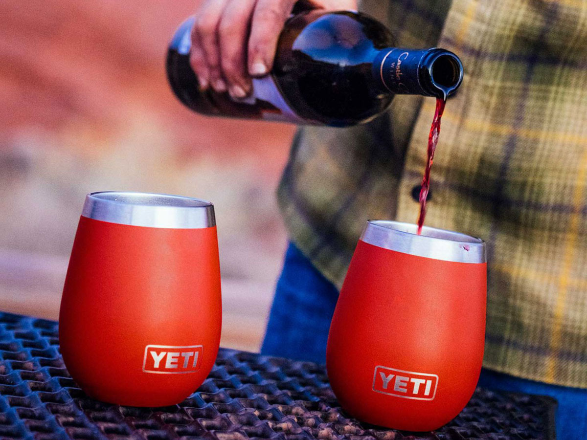 hand pouring wine in to YETI 10oz Rambler Wine Tumbler
