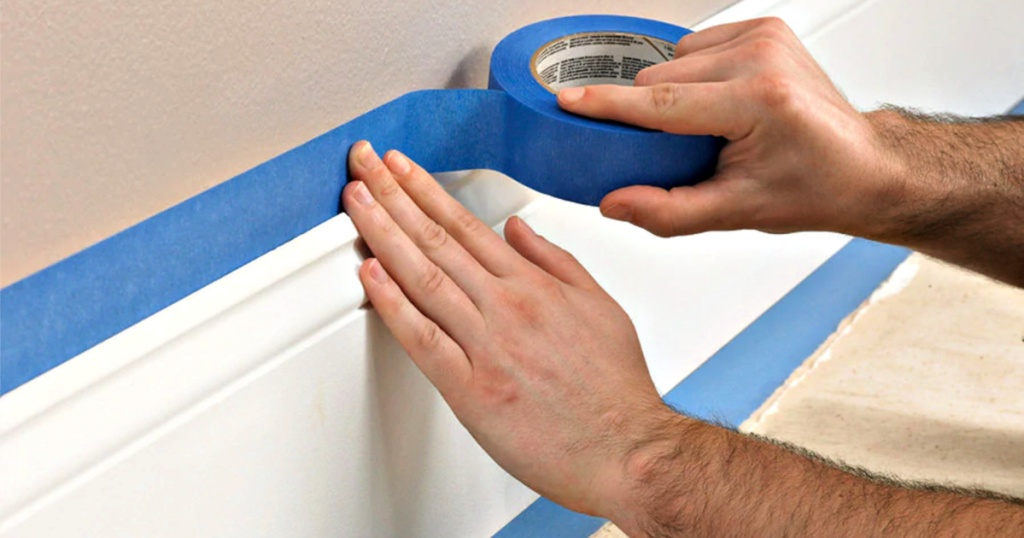 3M Multi-Surface 3-Pack Painters Tape being used on baseboards