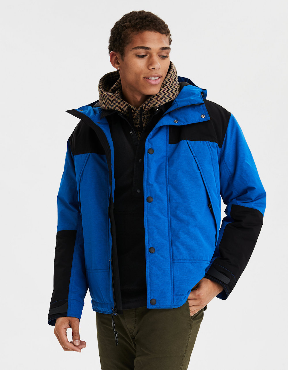 Man wearing blue AE All Weather Parka
