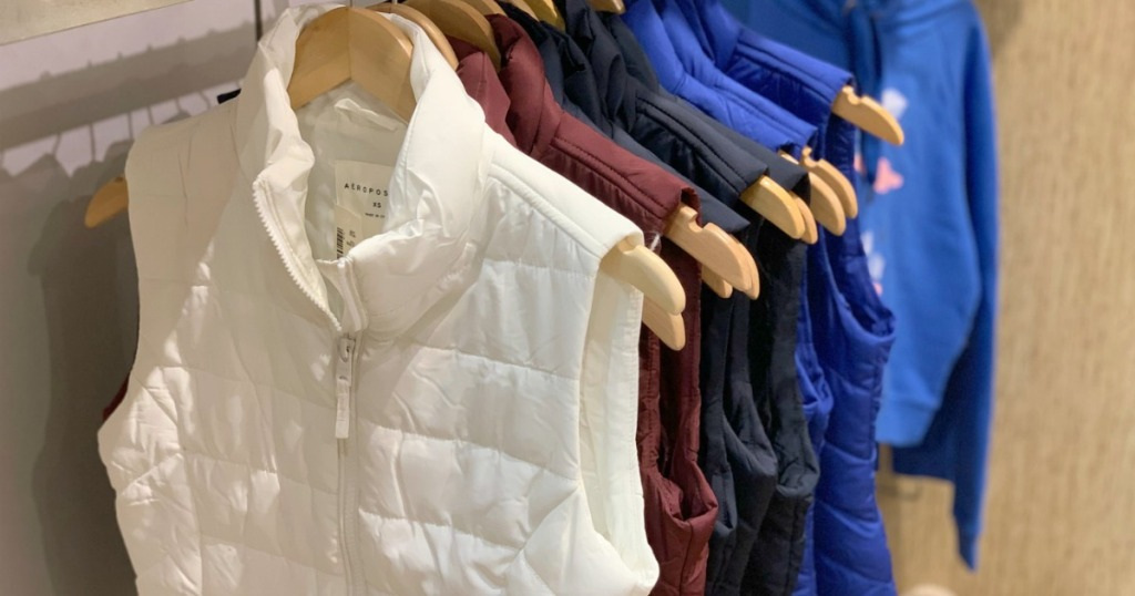 Women's puffer vests on display in-store