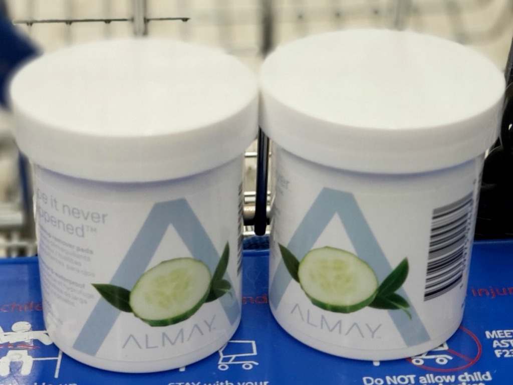 Two containers of Almay brand eye makeup remover pads in cart at Walgreens