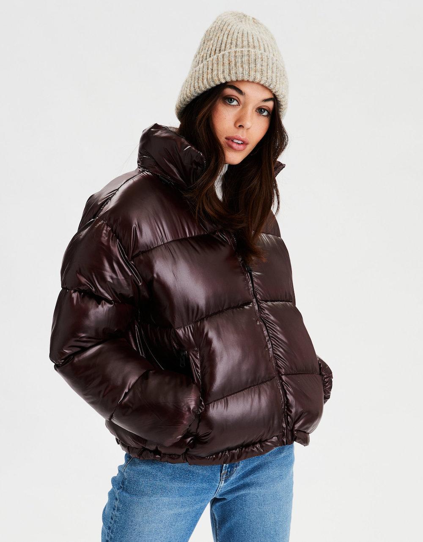 Woman wearing beanie and American Eagle Puffer Coat