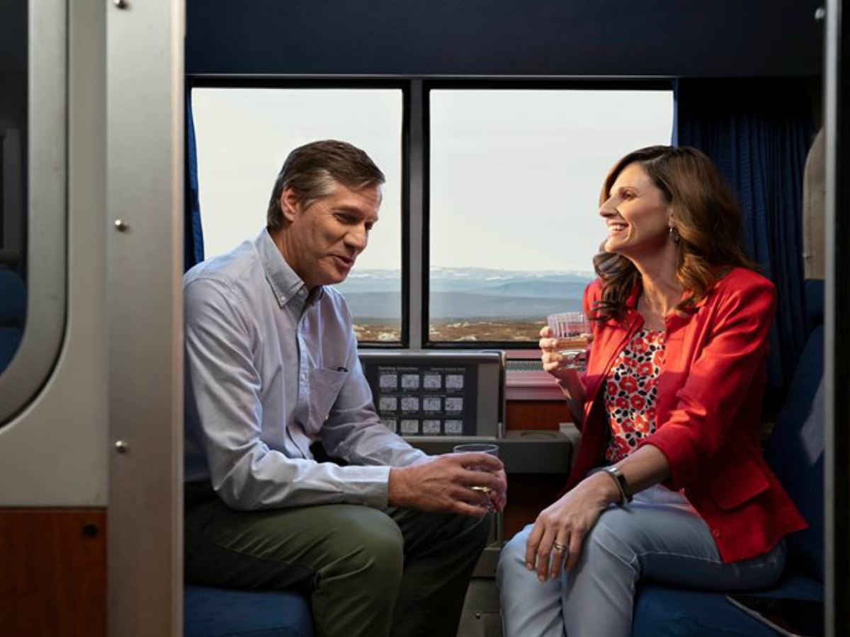 Man and woman in a room on a train